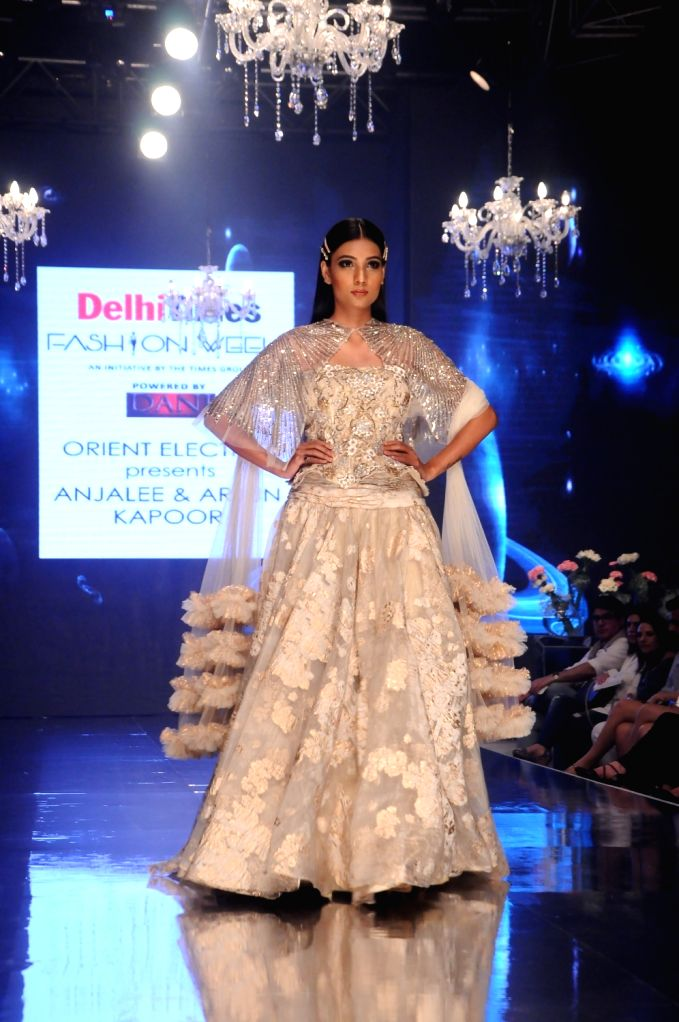 A model walks the ramp on Day 1 of the Delhi Times Fashion Week, on Sep 21, 2019.