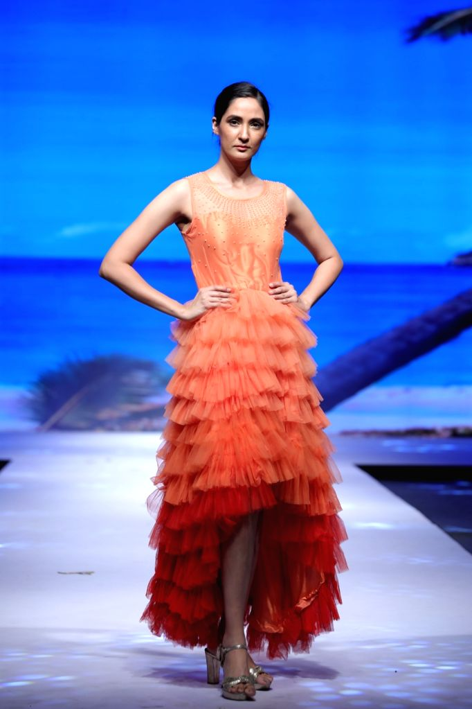 A model walks the ramp showcasing a creation by the students of JD Institute of Fashion Technology at a fashion event in New Delhi, on June 14, 2019.