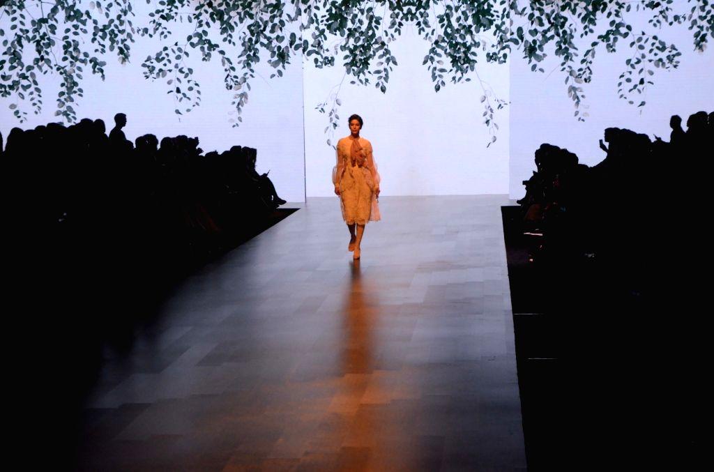 A model walks the ramp showcasing Aikeyah's creation during the Lakme Fashion Week (LFW) Summer/Resort 2019 in Mumbai on Feb 2, 2019.