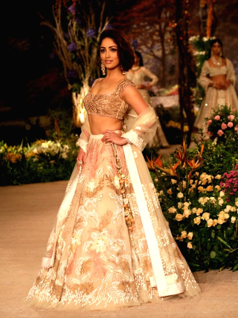 A model walks the ramp showcasing creations of Fashion designer Reynu Taandon at India Couture Week 2018 in New Delhi, on July 29, 2018.