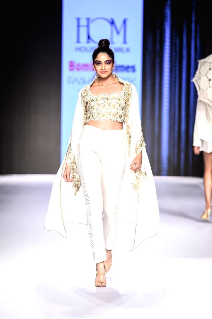 A model walks the ramp showcasing designer Reshma Merchant's creation on the second day of Bombay Times Fashion Week 2018, in Mumbai on March 31, 2018.