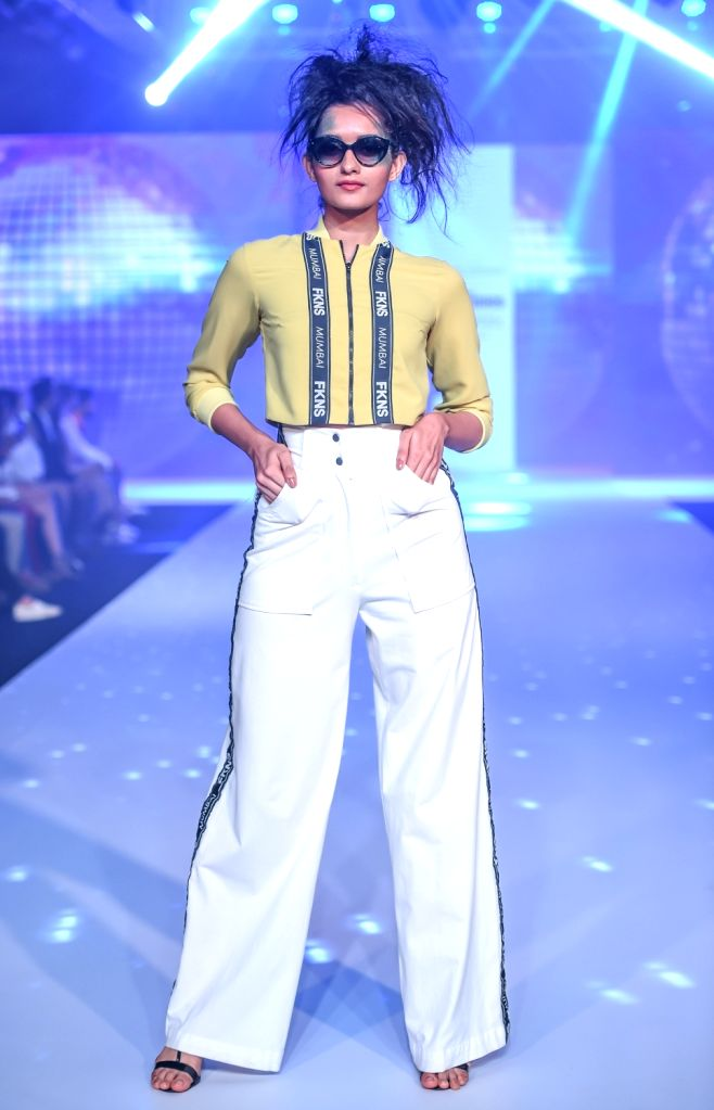A model walks the ramp showcasing fashion designer Narendra Kumar's creation on the second day of Bombay Times Fashion Week 2018, in Mumbai on March 31, 2018. - Narendra Kumar