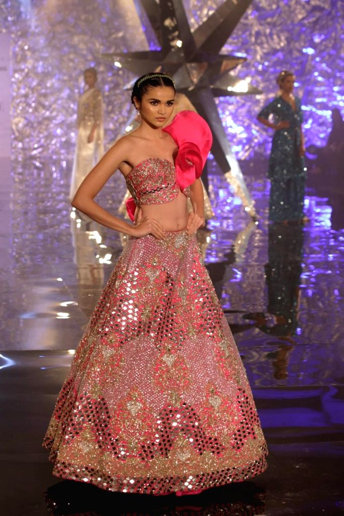 A model walks the ramp showcasing fashion designer Suneet Verma's creation at India Couture Week 2018, in New Delhi on July 27, 2018. - Suneet Verma