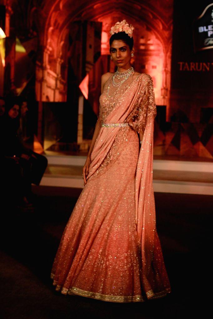 A model walks the ramp showcasing fashion designer Tarun Tahiliani's creation at Blender's Pride Fashion Tour in Gurugram, on Dec 7, 2018.