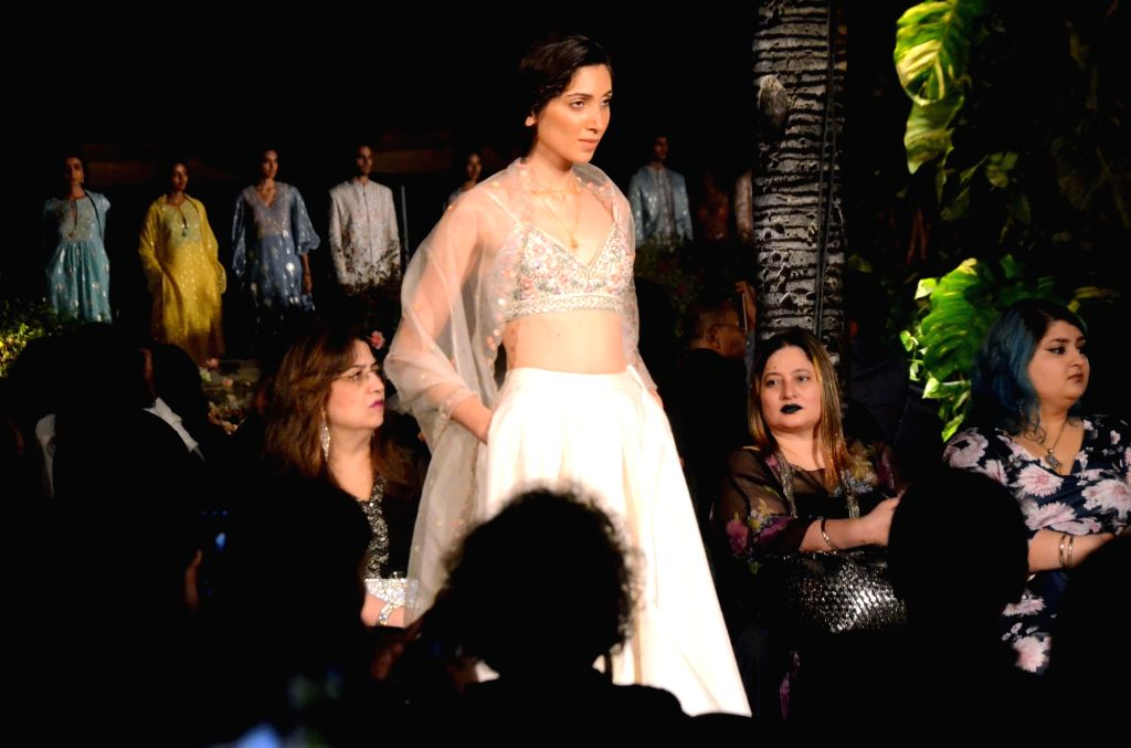 A model walks the ramp showcasing fashion designer Anita Dogre's creation on Day 2 of the Lakme Fashion Week (LFW) Summer/Resort 2019 in Mumbai, on Jan 31, 2019.