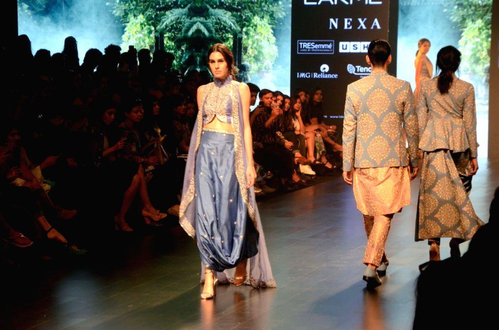 A model walks the ramp showcasing fashion designers Sonam and Paras Modi's creation on Day 3 of the Lakme Fashion Week Summer/Resort 2019 in Mumbai, on Feb 1, 2019. - Modi