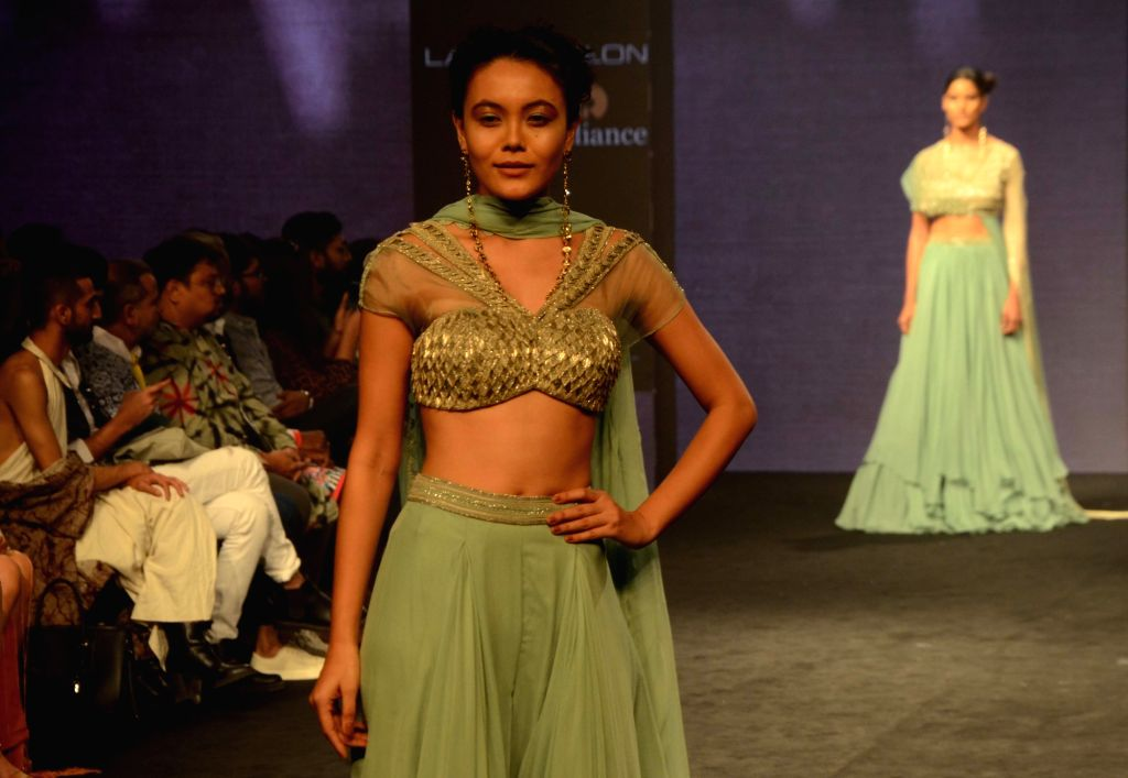 A model walks the ramp showcasing fashion designer Anjali Verma's creation during Lakme Fashion Week (LFW) Summer/Resort 2019 in Mumbai on Feb. 2, 2019.