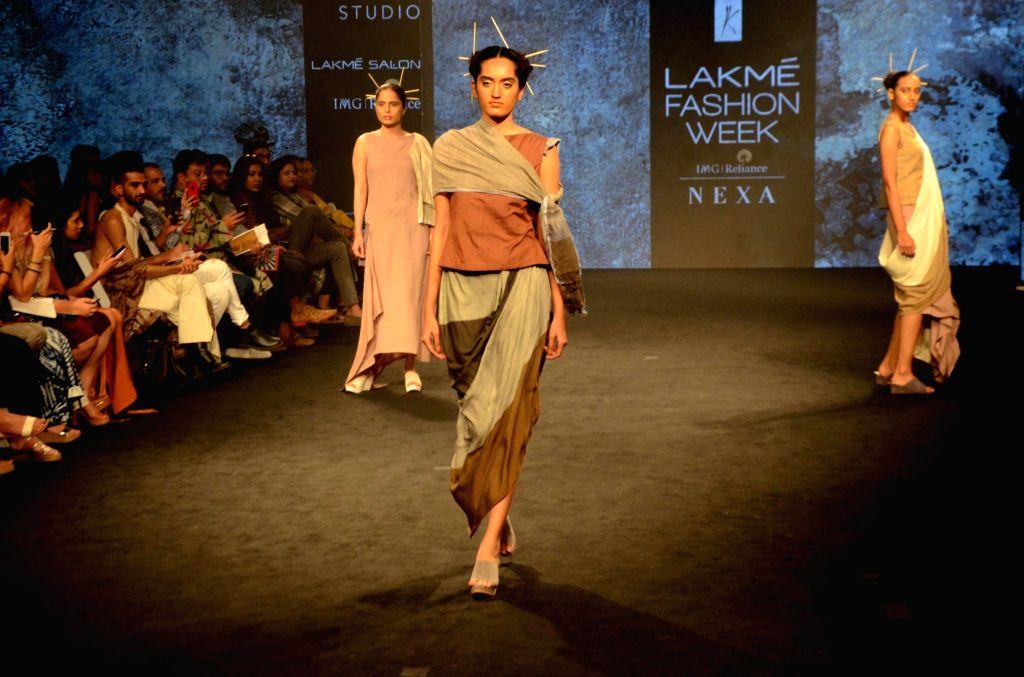 A model walks the ramp showcasing fashion designer Kanchan More Sabharwal's creation during Lakme Fashion Week (LFW) Summer/Resort 2019 in Mumbai on Feb. 2, 2019. - Anjali Verma
