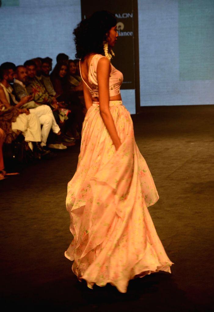 A model walks the ramp showcasing fashion designer Vaani Raghupathy's creation during Lakme Fashion Week (LFW) Summer/Resort 2019 in Mumbai on Feb. 2, 2019.