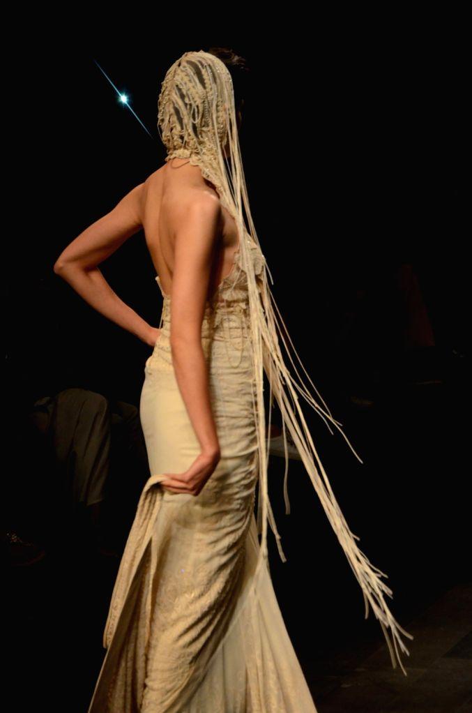 A model walks the ramp showcasing fashion designer Abhishek Sharma's creation during the Lakme Fashion Week (LFW) Summer/Resort 2019 in Mumbai on Feb 2, 2019. - Abhishek Sharma