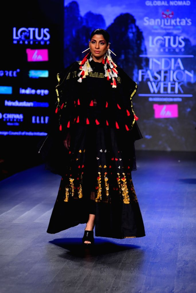 A model walks the ramp showcasing fashion designer Sanjukta Dutta's creation on the second day of Lotus India Fashion Week in New Delhi, on March 14, 2019.