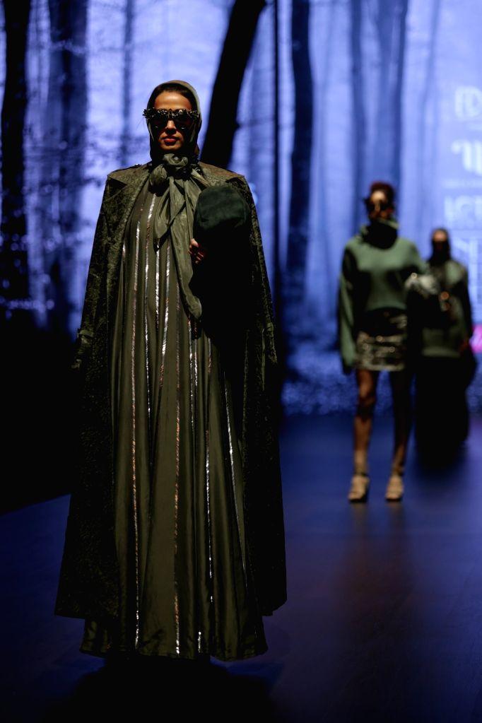 A model walks the ramp showcasing fashion designer Nikita Mhaisalkar's creation on the second day of Lotus India Fashion Week in New Delhi, on March 14, 2019.
