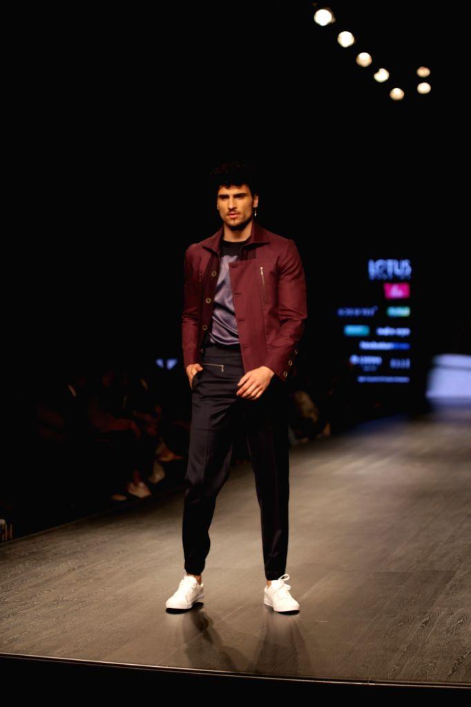 A model walks the ramp showcasing fashion designer Sanjukta Dutta's creation on the second day of Lotus India Fashion Week in New Delhi, on March 14, 2019.
