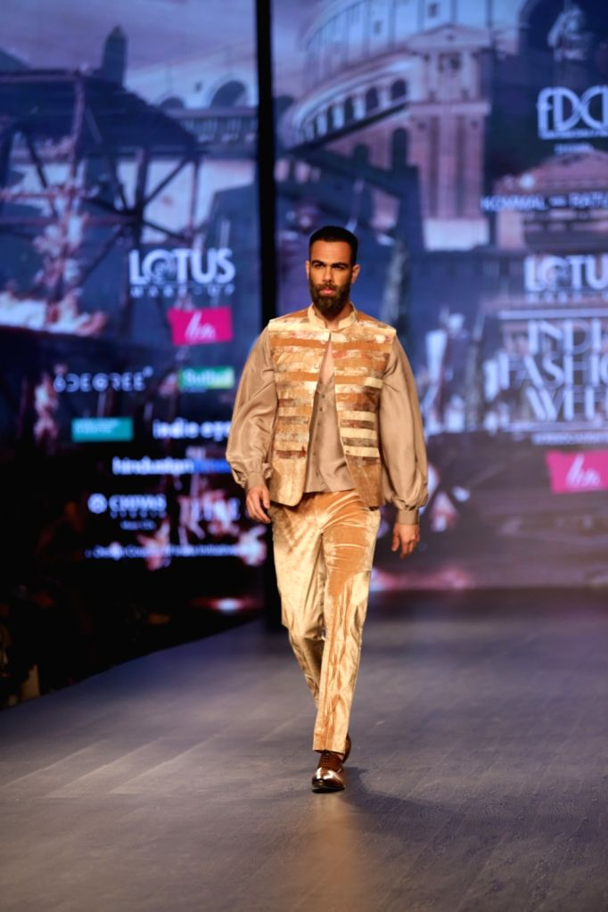 A model walks the ramp showcasing fashion designers Kommal and Ratul Sood's creation on the second day of Lotus India Fashion Week in New Delhi, on March 14, 2019.