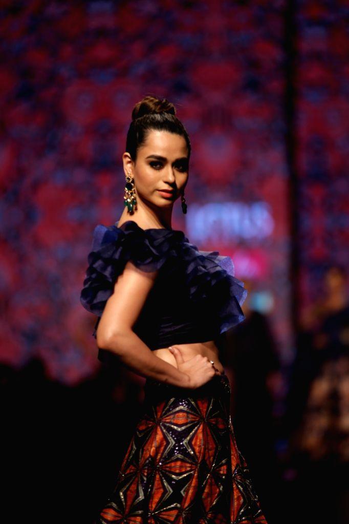 A model walks the ramp showcasing fashion designer Charu Parashar's creations on the third day of Lotus India Fashion Week in New Delhi, on March 15, 2019.