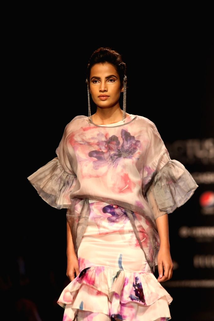 A model walks the ramp showcasing fashion designer Nidhi Yasha's creation on the first day of Lotus Make-up India Fashion Week, in New Delhi on Oct 9, 2019.