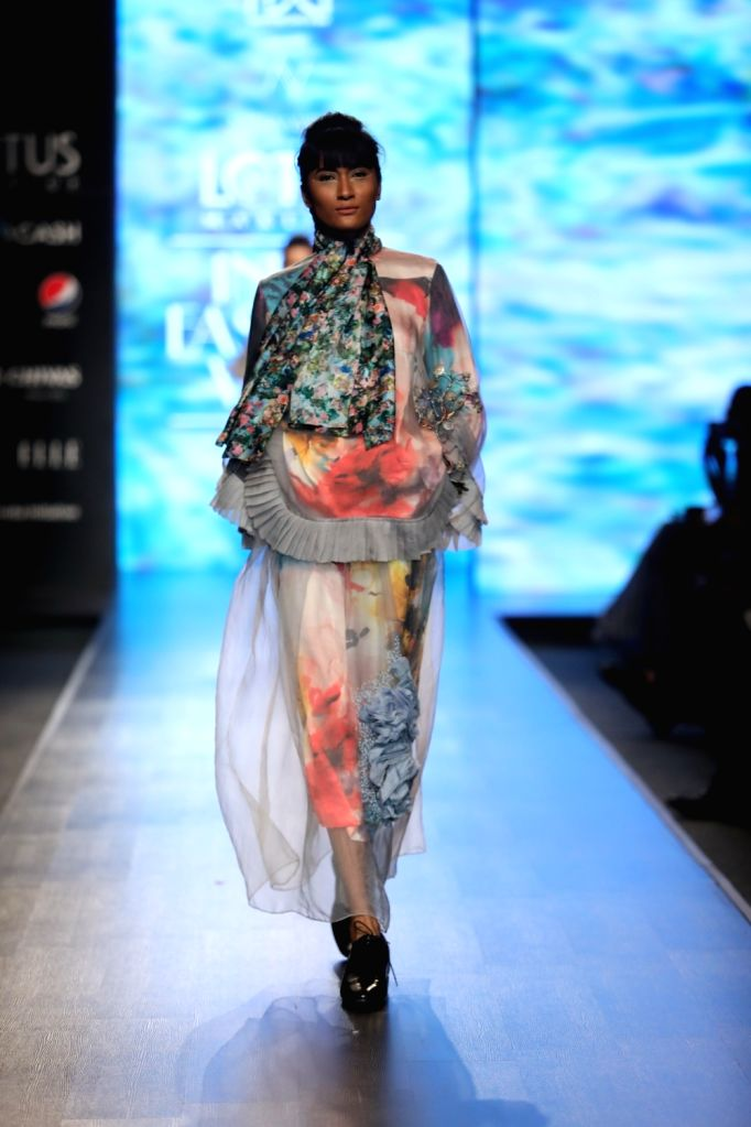 A model walks the ramp showcasing fashion designer Nidhi Yasha's creations on the first day of Lotus Make-up India Fashion Week, in New Delhi on Oct 9, 2019.