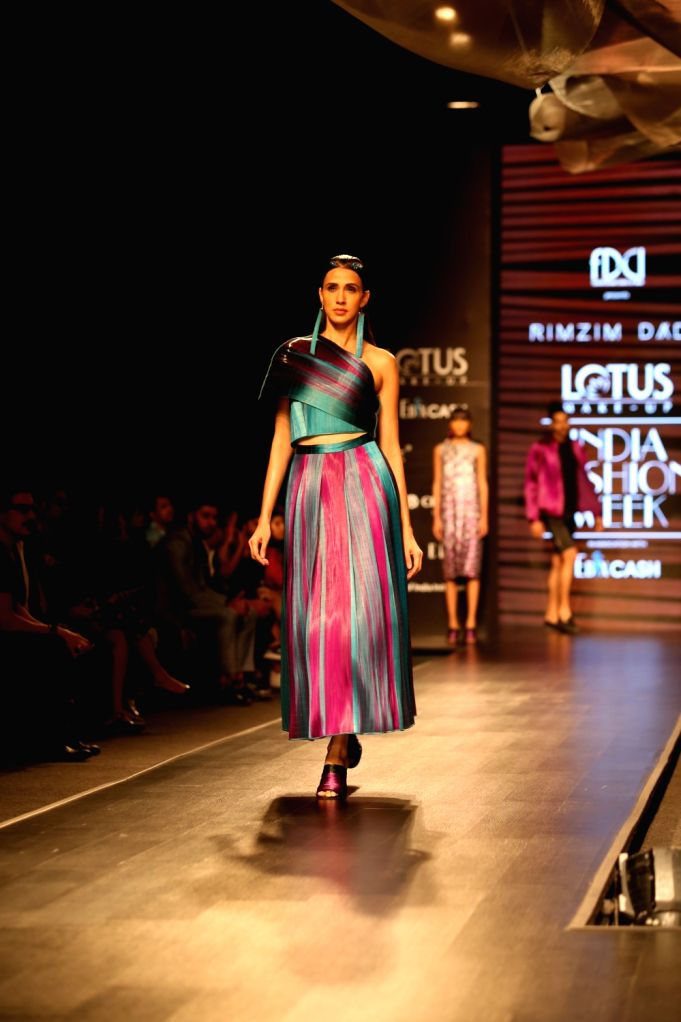 A model walks the ramp showcasing fashion designer Rimzim Dadu's creation on the first day of Lotus Make-up India Fashion Week, in New Delhi on Oct 9, 2019.