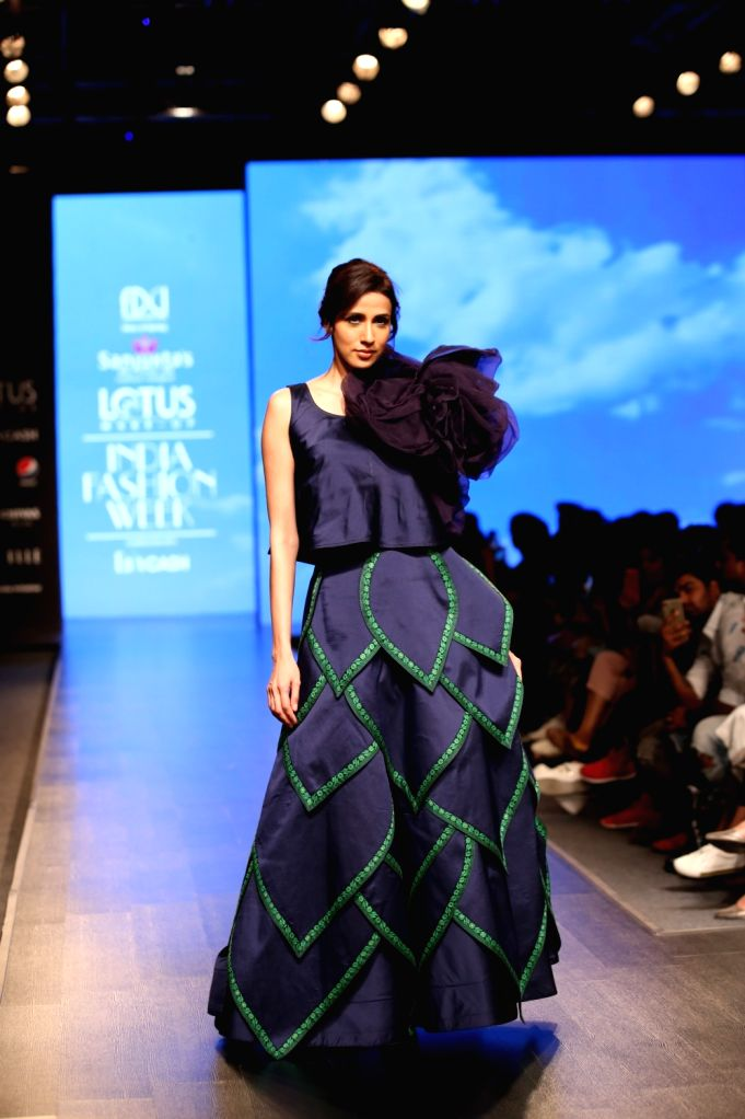 A model walks the ramp showcasing fashion designer Sanjukta Dutta's creation on the second day of Lotus Make-up India Fashion Week, in New Delhi on Oct 10, 2019.