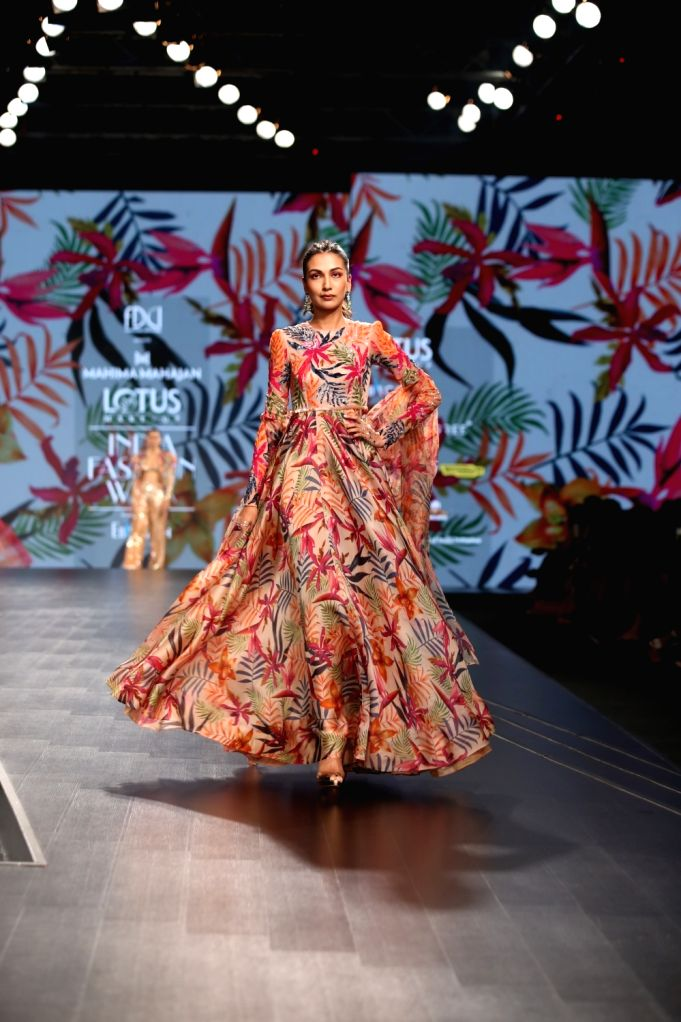 A model walks the ramp showcasing fashion designer Mahima Mahajan's creation on the third day of Lotus Make-up India Fashion Week, in New Delhi on Oct 11, 2019. - Mahima Mahajan