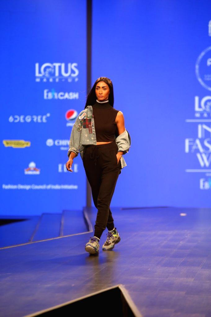 A Model walks the ramp showcasing for Pepsi X Huemn at Lotus India Fashion Week, Oct 9, 2019.