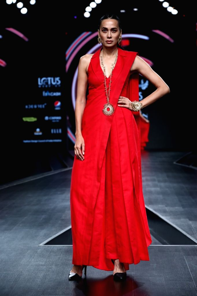 A model walks the ramp showcasing Nidhika Shekhar's creations on the third day of Lotus Make-up India Fashion Week, in New Delhi on Oct 11, 2019.