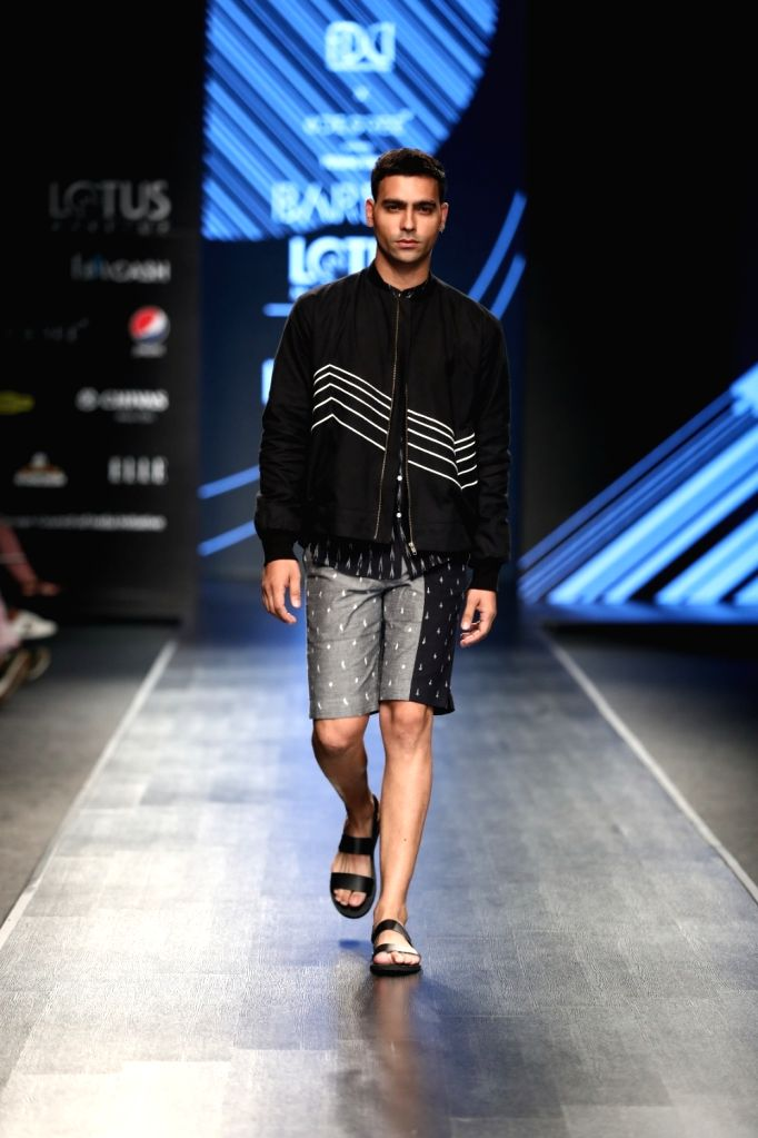 A model walks the ramp showcasing the collection of menswear label Bareek on the fourth day of Lotus Make-up India Fashion Week, in New Delhi on Oct 12, 2019.