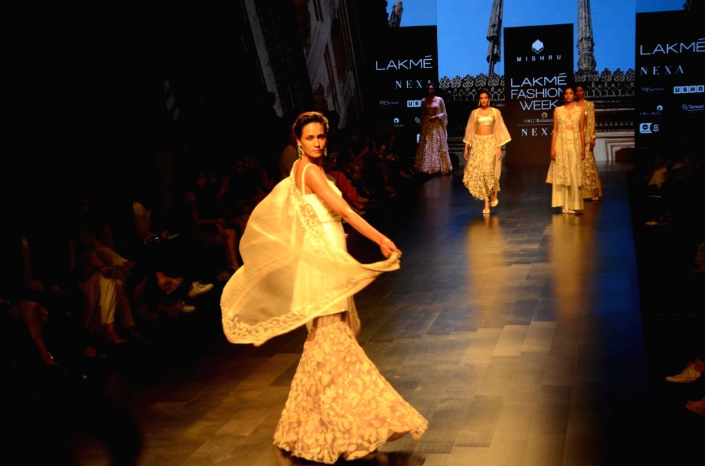 A model walks the ramp showcasing the creation of fashion designer Swapna Anumolu's label Mishru during the Lakme Fashion Week (LFW) Summer/Resort 2019 in Mumbai on Feb 3, 2019.