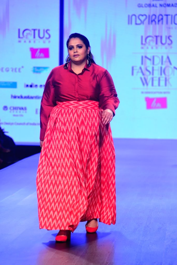 A model walks the ramp showcasing the creation of 'Inspiration Collections' on the second day of Lotus India Fashion Week in New Delhi, on March 14, 2019.