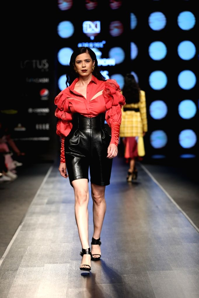 A model walks the ramp showcasing the creation of of fashion designer Sameer Madan on the fourth day of Lotus Make-up India Fashion Week, in New Delhi on Oct 12, 2019.