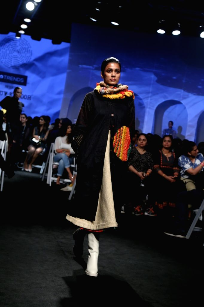 A model walks the ramp showcasing the creation of fashion designers Masaba Gupta and Kunal Rawal on Day 1 of the Lakme Fashion Week Summer/Resort 2020, in Mumbai on Feb 11, 2020. - Masaba Gupta