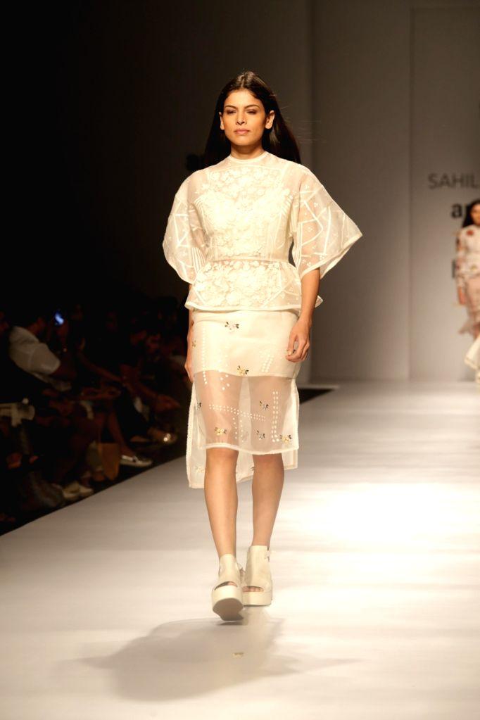 A model walks the ramp showcasing the creations of fashion designer Sahil Kochhar at Amazon India Fashion Week Summer Spring in New Delhi, on Oct 12, 2017.