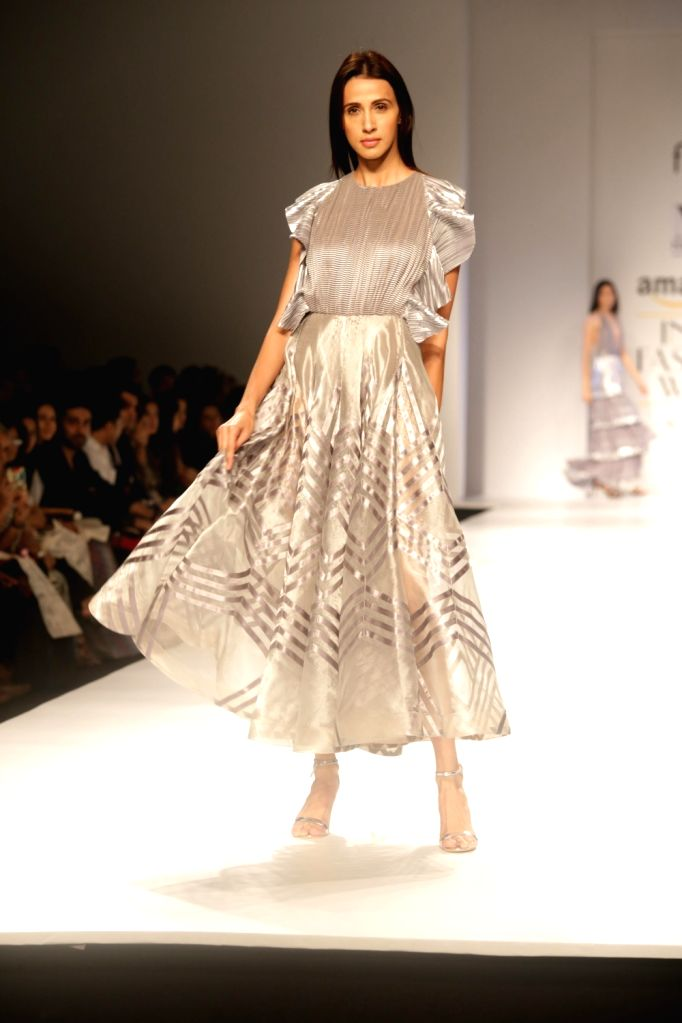A model walks the ramp showcasing the creations of fashion designer Nikita at Amazon India Fashion Week Summer Spring in New Delhi, on Oct 12, 2017.