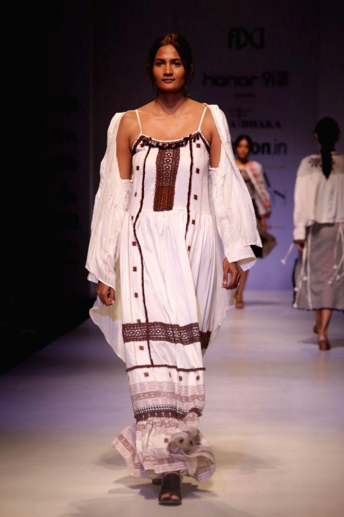 A model walks the ramp showcasing the creations of fashion designer Rina Dhaka at Amazon India Fashion Week Summer Spring in New Delhi, on Oct 12, 2017.