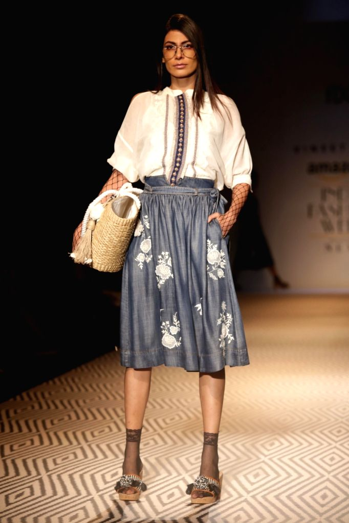 A model walks the ramp showcasing the creations of fashion designer Vineet Bahl at Amazon India Fashion Week Summer Spring in New Delhi, on Oct 12, 2017.