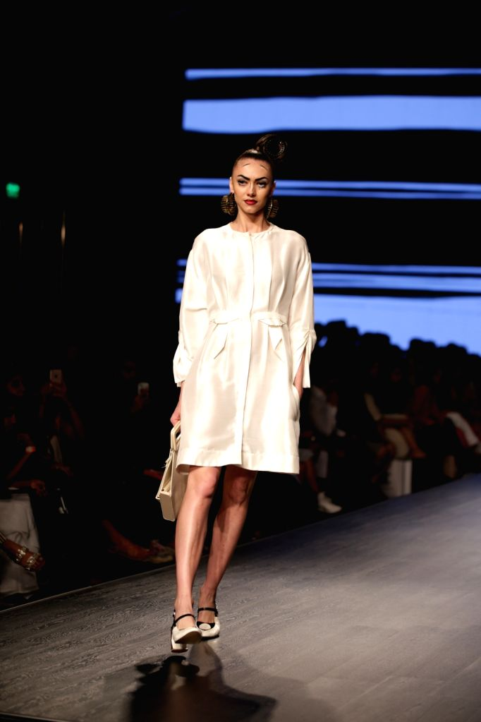 A model walks the ramp showcasing the creations of fashion designer Nitin Bal Chauhan on the second day of Lotus India Fashion Week in New Delhi, on March 14, 2019. - Nitin Bal Chauhan