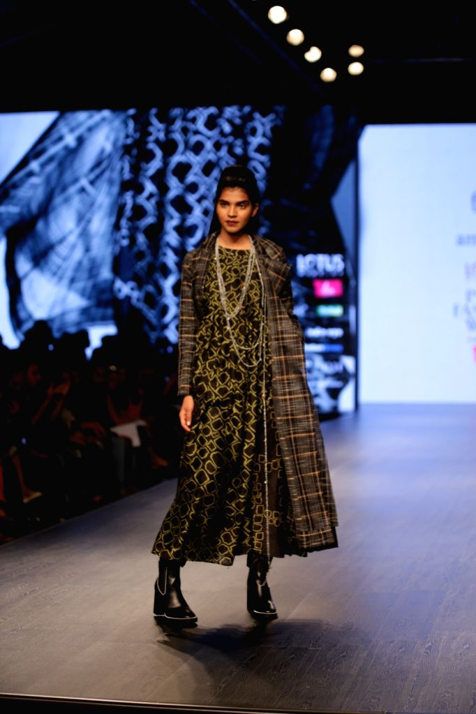 A model walks the ramp showcasing the creations of fashion designer Amrich on the third day of Lotus India Fashion Week in New Delhi, on March 15, 2019.