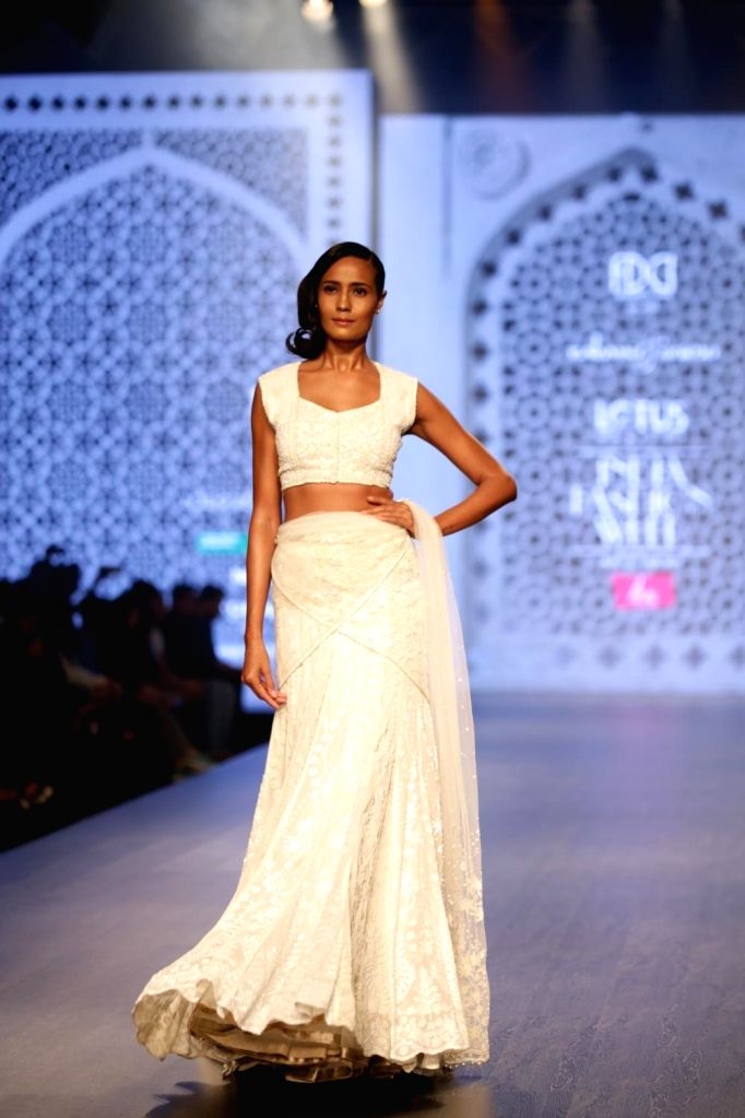 A model walks the ramp showcasing the creations of fashion designer Rabani and Rakha on the third day of Lotus India Fashion Week in New Delhi, on March 15, 2019.