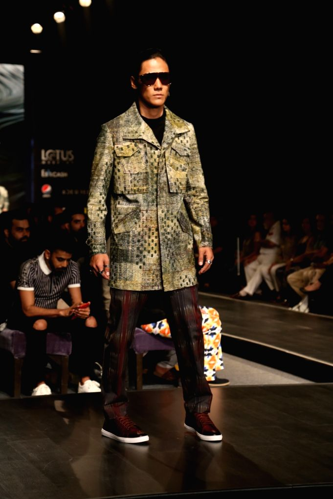 A model walks the ramp showcasing the creations of fashion designer Pawan Sachdeva on the fourth day of Lotus Make-up India Fashion Week, in New Delhi on Oct 12, 2019.
