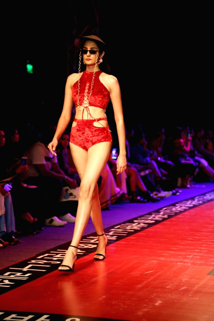 A model walks the ramp showcasing the creations of fashion designers Shivan and Narresh on the fourth day of Lotus Make-up India Fashion Week, in New Delhi on Oct 12, 2019.