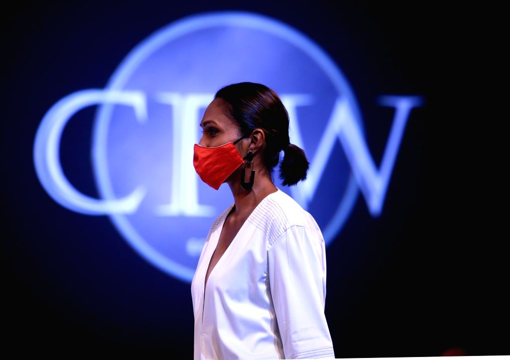 A model wearing a face mask presents a fashion creation during the Colombo Fashion Week held amid the COVID-19 outbreak in Colombo, Sri Lanka, Aug. 13, 2020. ...