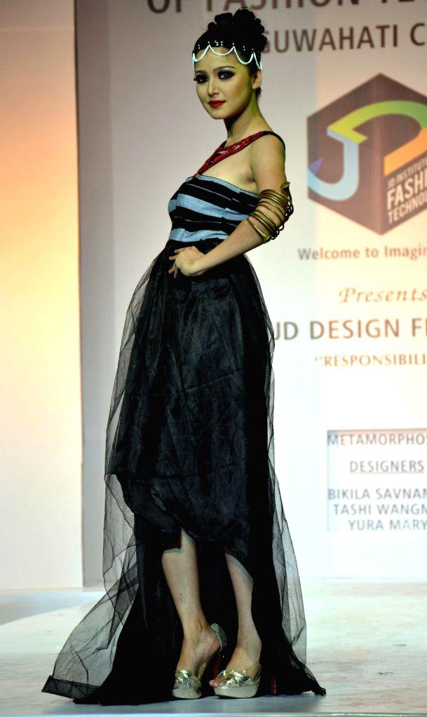A models walks the ramp during 9th JD Design Fest 2014 at ITA Machkhowa centre in Guwahati  on July 27, 2014.