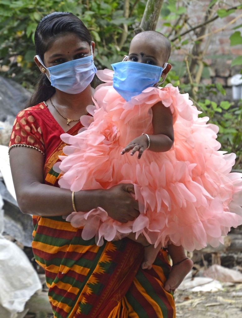 A mother along with her child enjoys on the occasion of Mother's Day during the extended nationwide lockdown imposed to mitigate the spread of coronavirus, in Noida on May 10, 2020.