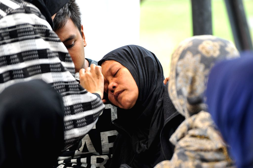 A mother of one of the victims from the crashed ATR 42-300 Trigana Air Services' plane fainted while waiting for the body of her daughter arrive at the ...