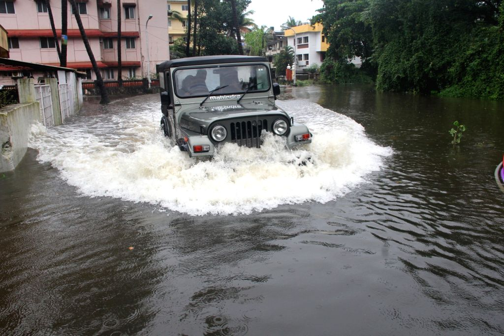 A motorist struggles through a water logged road in Taleigao, 7 kms from Panaji on June 29, 2016.