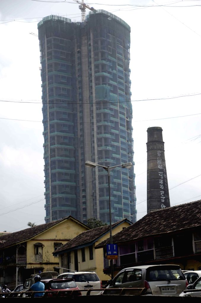 A multi-storey building comes up at the site which was earlier occupied by textile mills at Parel in Mumbai on Sept 7, 2014.