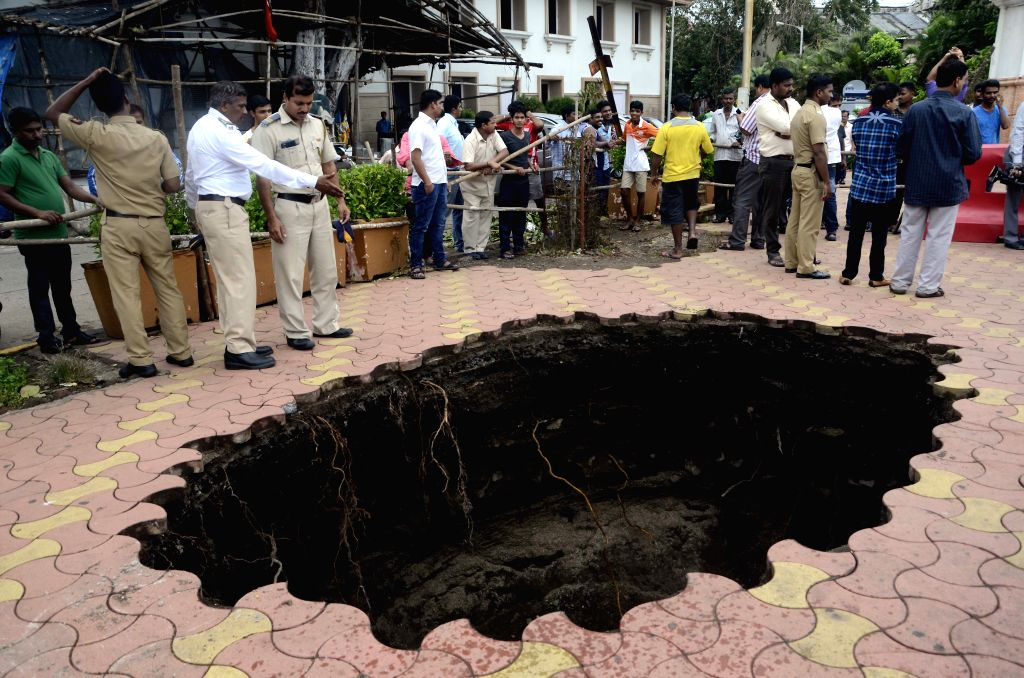 A Mumbai footpath caves-in after rains near Radio Club on June 24, 2015.
