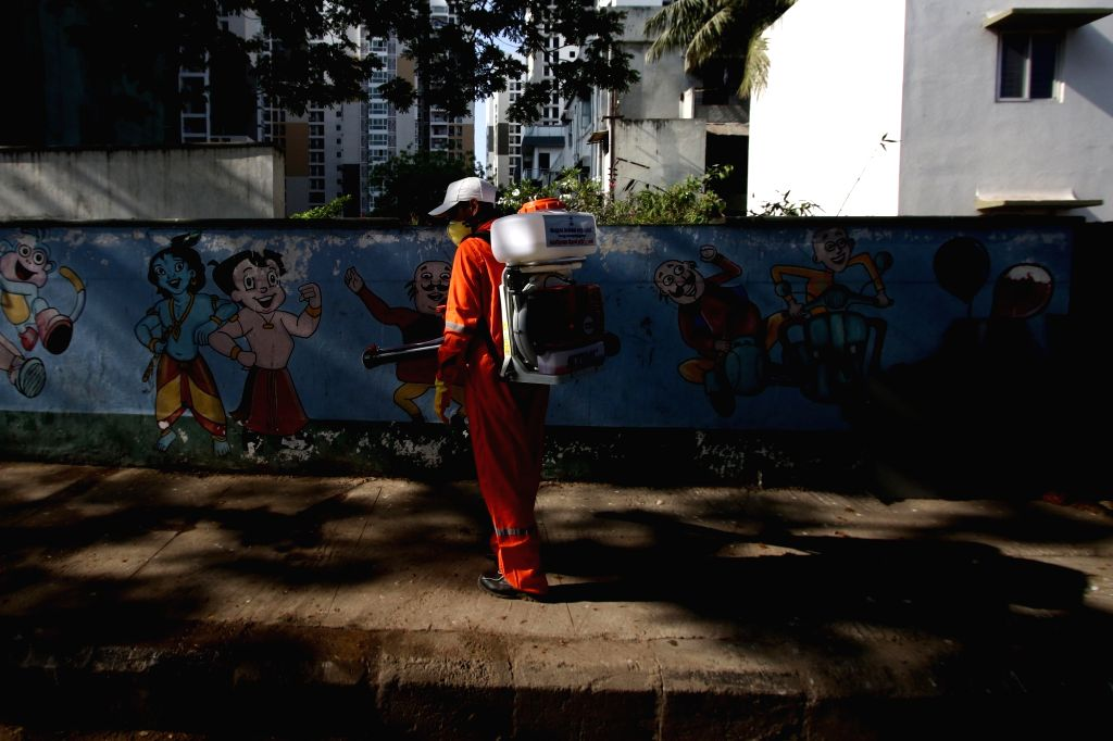 A municipal worker sprays disinfectant on Day 5 of the 21-day countrywide lockdown imposed to contain the spread of novel coronavirus, in Chennai on March 29, 2020.
