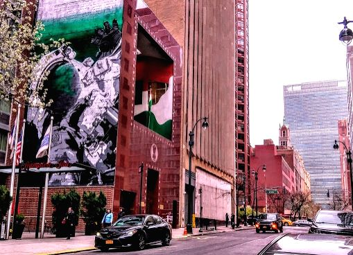 A mural painted on the side of the Indian Mission to the United Nations in New York shows an astronaut floating in space to symbolise the future of work and Mahatma Gandhi championing the dignity of ...