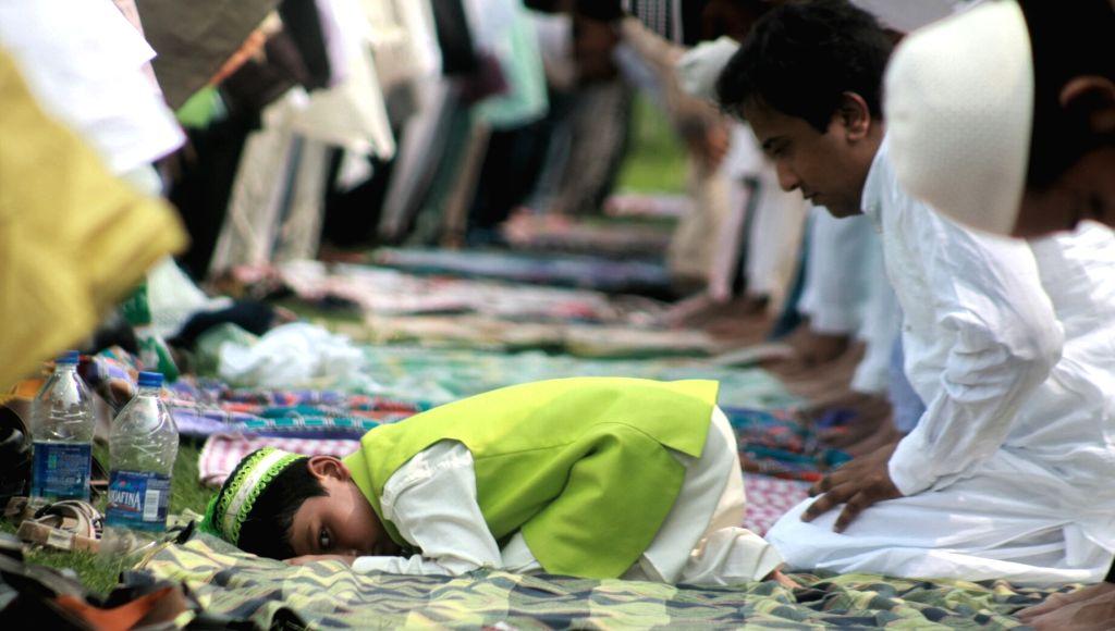 A muslim boy offer prayer on the occasion of Eid-ul-Fitr at Feroz Shah Kotla ground in New Delhi on June 26, 2017. - Feroz Shah Kotla
